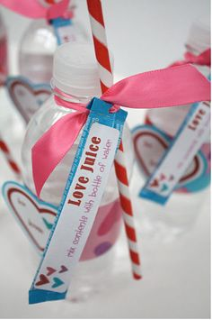 At Second Street created a valentine exchange gift using a water bottle, a straw and single serve packages of Hawaiian Punch. She provides free printables so we can make this too!