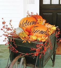 Thanksgiving front porch decorating idea. Most people think about just carving a pumpkin. Writing messages on them is an easy and lovely idea!