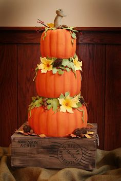 "This cake took the term ""carving pumpkins"" to a whole new level.  Hand-carved cakes sitting on another cake, hand-painted to look like a wooden crate."