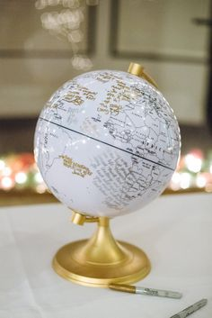 great idea for a guest book - a globe for the guests to sign! photo by Suzuran Photography http://ruffledblog.com/new-years-eve-cleveland-wedding #guestbook #weddingideas