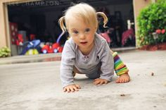 Kelle Hampton ought to be applauded for taking the fear out  of having a child with down syndrome and showing the BEAUTY instead. (seriously, have you seen a cuter child??)