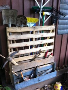Pallet patio tool rack.   First pallet project. Many maire to come. #pallet #pallettoolrack
