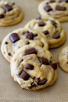 Chewy Chocolate Chunk Cookies and the secrets to thick, chewy, and soft cookies. By sallysbakingaddiction.com