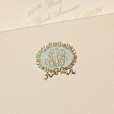 Bespoke Stationery | Ecru Empire Card with Aqua Bevelled Edges and Aqua and Gold Monogram.