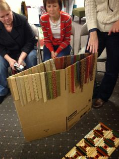 Timeless Traditions: Quilters Gathered had a great idea use a cardboard box to keep strips close and neat.