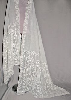 Shawl. Muslin cotton, white embroidery. India, 1806-1814. White muslin shawls, as well as white embroidered muslin dresses or pelisses were specially made in India for the European market and ready to be sewn.