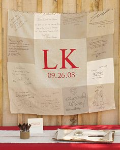 guest book quilt! guests signed pieces of linen instead of a book...this is great!