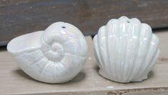 Stocking Stuffer Idea... Salt & Pepper Shakers - Coastal Beach Kitchen Decor Pearlized white ceramic seashell salt & pepper shakes are perfect for any coastal themed home or as a gift.  #stockingstuffer #coastalkitchen