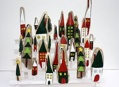 LIME RIOT: Driftwood Advent Calendar?..doing this.  Love the idea of building the village instead of giving cheesy cheap gifts each day.