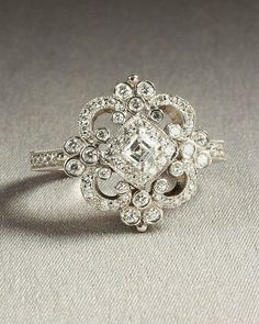 I'm usually not into big engagement rings, but I love the vintage look of this!