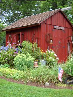 Displaying vintage gardening tools, on or around a shed, helps to connect the outside of a primitive home to the inside ~