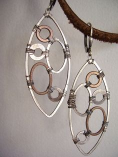 Industrial Evolution earrings made of hand forged copper and sterling silver ellipses and hoops- dna jewelry designs