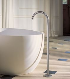 The gracious VOLA 090FM floor mounted tap.