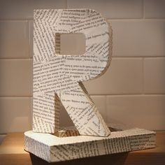 Name spelled in book page covered letters...yes