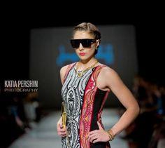 Joseph Ribkoff Dress. Mirror Sheath dress with slimming black side panels.