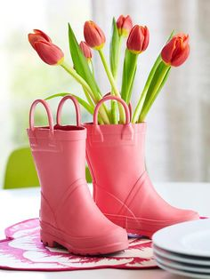 Place slender cylinder vases into old rain boots! The result is an adorable way to display fresh flowers. Get more Mother's Day Ideas: http://www.bhg.com/holidays/mothers-day/gifts/mothers-day-flowers-ideas/?socsrc=bhgpin040912boots