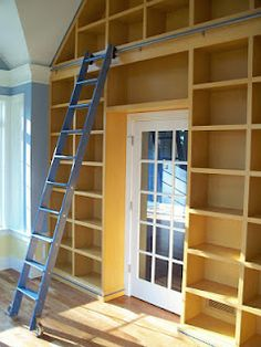 shelves over a door or window - with a rolling ladder