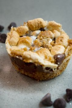 S'more Cookies Cupcakes  Combine 2 cups of freshly ground graham cracker crumbs, 3/4 cups of melted butter and 1/3 cups sugar in a large bowl. In a separate bowl, combine 2 cups of semi-sweet chocolate chips and 3 cups of mini marshmallows