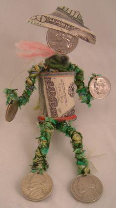 VooDoo Spoolie Doll ~ to help you remember to spend less money in the coming year.  Ü