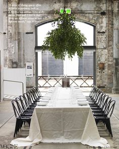 Love this draped, oversized table cloth and hanging greenery