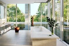 Architectural Digest; love the light of this master bathroom