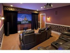 Round up the family for an exceptional movie night in this amazing in-home theater!