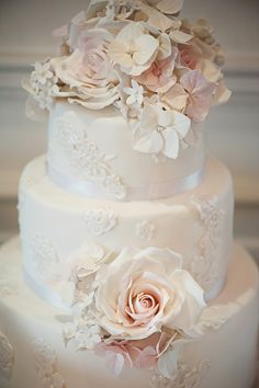 Lace and rose vintage wedding cake as featured in Brides.