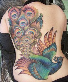 Colorful peacock back tattoo by Teniele Sadd.
