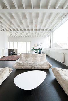 white beam ceiling, dark floors - light living