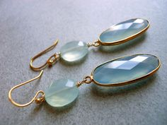 I found these gorgeous grey-blue chalcedony bezeled pieces surrounded by gold vermeil and stared them for a good while before seeing that they pick up the color in the aqua chalcedony coins beautifully. You will receive the exact pair pictured. They are nice and long- about 2.5 inches. 14k gold plated earwire. Your earrings will arrive beautifully giftboxed. If you would like to upgrade to leverbacks please select the from the upgrade category on the lower left.