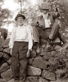 Battle of Gettysburg veterans. The picture was taken in 1913, at a reunion held on the battlefield. The man sitting on the rocks is a Confederate soldier, and the man standing is a Union soldier.
