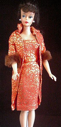 Vintage Barbie - Golden Elegance, 1963.  I still have the whole outfit, including hat and purse.   Beautifully made with full silk lining and real fur. Still have this one!