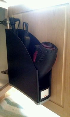 Velcro + magazine rack = perfect storage for blow dryer, straightener, and curling iron.
