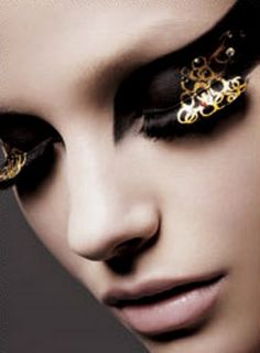 Fabulous and fierce. dramatic makeup, eye makeup, eyelash extensions, makeup box, dramatic eyes, gold rings, goth art, black gold, beauty salons