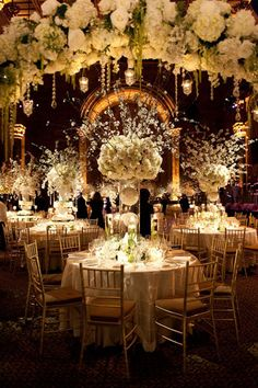 Centerpieces - Dramatic all-white centerpieces. - Photo Credit: M Bénédicte Verley/Flowers By: Tantawan Bloom