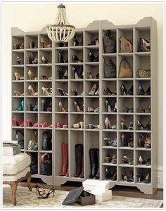 """Walk in closet """"Shoe"""" wall."""