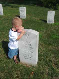 My grandson at my Dad's grave J.B.N.C.    St Louis MO. They never got a chance to meet.