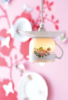 Teacup lights  A great way to use teacups and saucers from an old tea set.