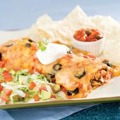 Chicken Enchilada's: Mexican Food! Chicken Enchiladas!  Who doesn't love them? I must confess, I love Mexican food and wrapping up your food converts it into a social happening,