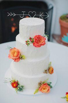 initial + arrow cake topper, photo by Matthew Morgan http://ruffledblog.com/southwestern-san-clemente-wedding #weddingideas #caketopper