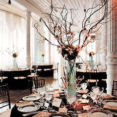 Centerpiece: Sticks and field flowers in a tall vase