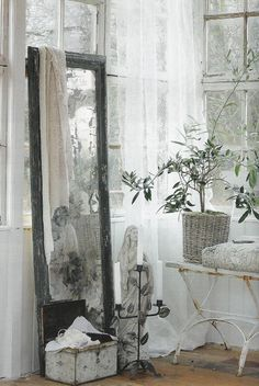 love the lace hanging on the mirror