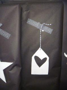 "Black kraft gift wrap + white heart label + black-and-white baker's twine + grey ""love"" washi tape."