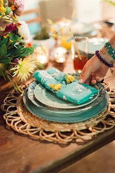 Place Setting: Aqua prints, patterned plates, and easy napkin fold.