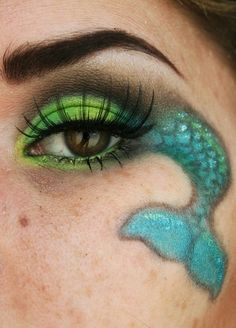 Face paint on pinterest face paintings cheek art and for Fish eyes in paint