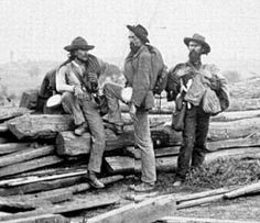 One of my favorite photos of the Civil War. Three Confederate Prisoners taken after the Battle of Gettysburg. Notice the one on the far right, holding his knapsack, as he is determined to make an individual out of himself