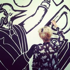...drawing on the wall...