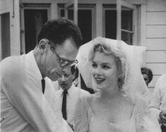 Actress Marilyn Monroe (1926-1962), with playwright Arthur Miller (1915-2005), on their wedding day, 1956.