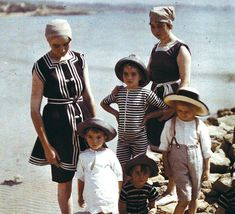 day at the beach. 1920s color photo found print family at the beach 20s bathing suits beach wear black stripe