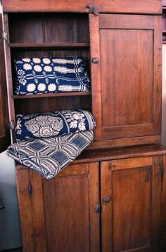 Love the cabinet and the coverlets